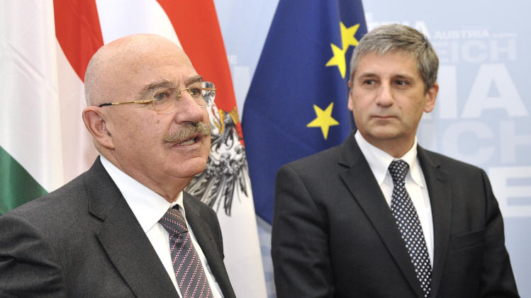 Hungarian Foreign Janos Martonyi, left, talks next to his Austrian counterpart   Michael Spindelegger during a press statement, in Vienna, Austria, on Wednesday, Dec. 5, 2012. (AP Photo/Hans Punz)