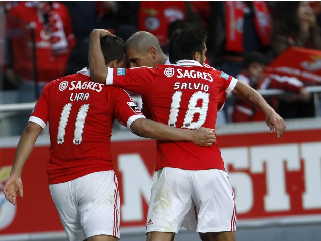 Benfica's Rodrigo Lima celebrates his goal against Moreirense with team mates Maxi Pereira and Eduardo Salvio during their Portuguese Premier League soccer match in Lisbon