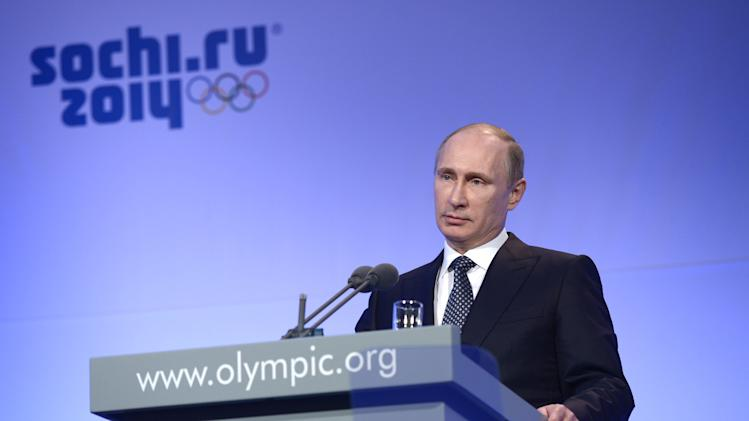 Russian President Vladimir Putin speaks during the IOC President's Gala Dinner in Sochi