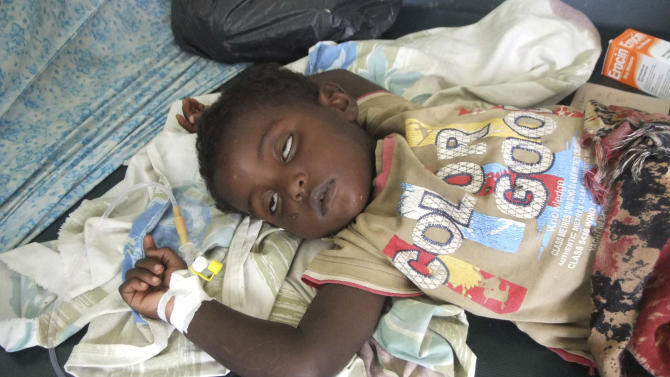 A malnourished child from southern Somalia on a bed at Banadir hospital in Mogadishu, Somalia, Monday, Aug 1, 2011. Tens of thousands of famine-stricken Somali refugees were cold and drenched after torrential rains overnight pounded their makeshift structures in the capital, Mogadishu. Rains are needed to plant crops and alleviate the drought that is causing famine in Somalia but on Saturday night the rains added to the misery of refugees who live in structures made of sticks and pieces of cloth.  (AP Photo / Farah Abdi Warsameh)