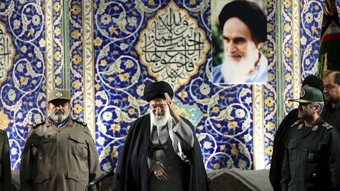 """In this photo released by an official website of the Iranian supreme leader's office on Wednesday, Nov. 20, 2013, Iran's Supreme Leader Ayatollah Ali Khamenei waves to members of the paramilitary Basij force at the Imam Khomeini Grand Mosque in Tehran, Iran. Khamenei says pressure from economic sanctions will never force the country into unwelcome concessions as nuclear negotiators resumed talks with world powers. Khamenei also blasted U.S. government policies, including threats of military action, but said Iran has """"no animosity'"""" toward the American people and seeks """"friendly"""" relations. (AP Photo/Office of the Supreme Leader)"""
