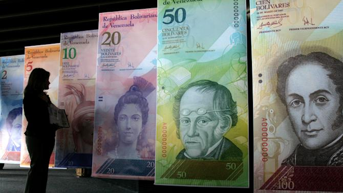 Venezuela sharply devalues its currency