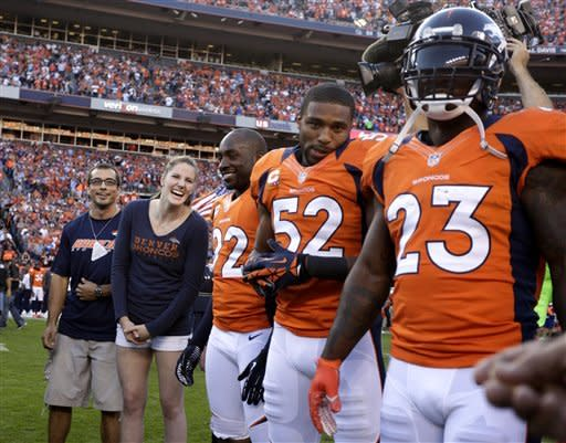 Manning successful in Denver debut, 31-19