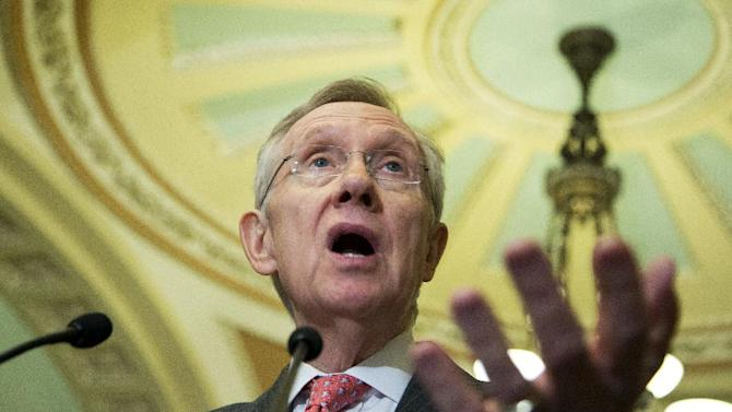 Senate Majority Leader Sen. Harry Reid of Nev gestures as he speaks to reporters on Capitol Hill in Washington, Tuesday, Feb. 12, 2013, prior to President Barack Obama's State of the Union address.   (AP Photo/Manuel Balce Ceneta)