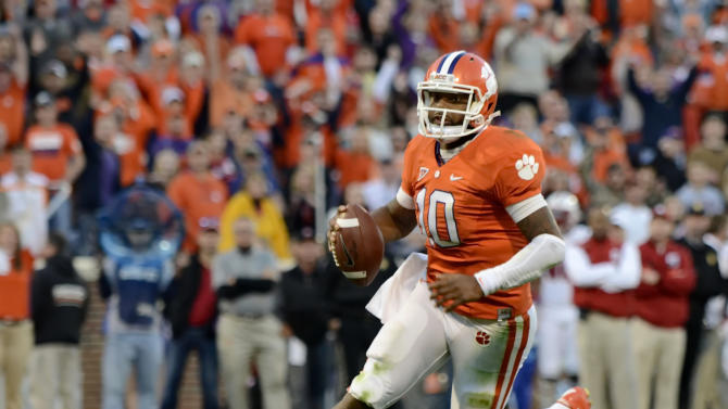Clemson quarterback Tajh Boyd (10) runs in for a touchdown during the first half of an NCAA college football game against North Carolina State, Saturday, Nov. 17, 2012, in Clemson, S.C. (AP Photo/Richard Shiro)