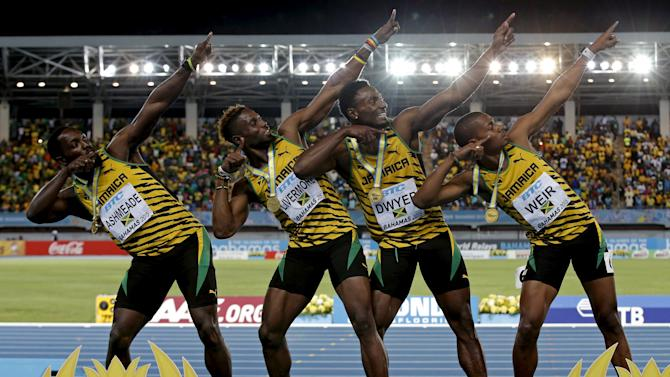 Jamaica's 4x200 relay team strike a pose on the medal podium after winning the event at the IAAF World Relays Championships in Nassau