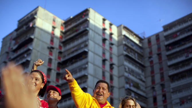 Venezuela's President Hugo Chavez waves to supporters during a campaign rally in Guarenas, Venezuela, Saturday, Sept. 29, 2012. Venezuela's presidential election is scheduled for Oct. 7. (AP Photo/Rodrigo Abd)