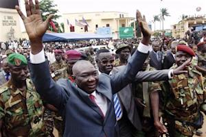 Central African Republic's new leader Michel Djotodia greets his supporters at a rally in downtown Bangui
