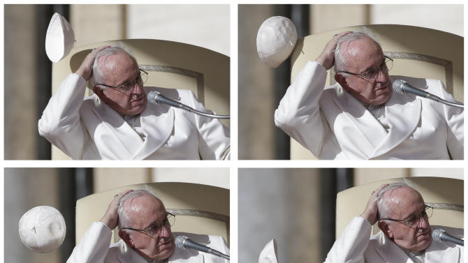 A combination photo shows a gust of wind blowing Pope Francis' skullcap during his weekly general audience in Saint Peter's Square at the Vatican
