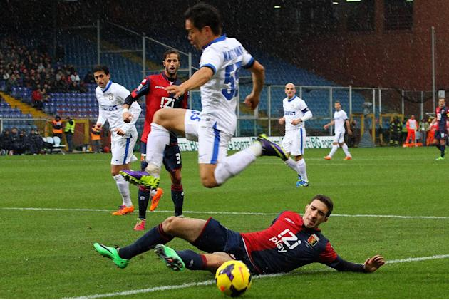 Inter Milan's Japanese defender Yuto Nagatomo jumps past Genoa's Sime Vrsaljko of Croatia during a Serie A soccer match between Genoa and Inter, at Genoa's Luigi Ferraris stadium Italy, Su