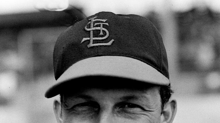FILE - In this March 6, 1948 file photo, Stan Musial, outfielder for the St. Louis Cardinals, poses for a portrait during spring training baseball in St. Petersburg, Fla. Musial, one of baseball's greatest hitters and a Hall of Famer with the Cardinals for more than two decades, died Saturday, Jan. 19, 2013, the team announced. He was 92.  (AP Photo/File)