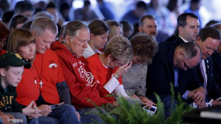 Persons in attendance at a memorial service bow their head in prayer, Thursday, April 17, 2014, in West, Texas, honoring those killed in a fertilizer plant explosion one year ago. (AP Photo/Tony Gutierrez)