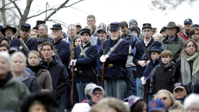 Civil War re-enactors depicting Union soldiers stand amongst spectators during a ceremony to mark the 149th anniversary of President Abraham Lincoln's delivery of the Gettysburg Address at Soldier's National Cemetery in Gettysburg, Pa., Monday, Nov. 19, 2012. Director Steven Spielberg and historian Doris Kearns Goodwin were also on hand to deliver remarks and participate in a wreath-laying ceremony. (AP Photo/Patrick Semansky)