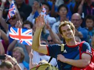 Great Britain's Andy Murray celebrates after winning the men's singles gold medal match of the London 2012 Olympic Games by defeating Switzerland's Roger Federer, at the All England Tennis Club in Wimbledon, southwest London, on August 5, 2012