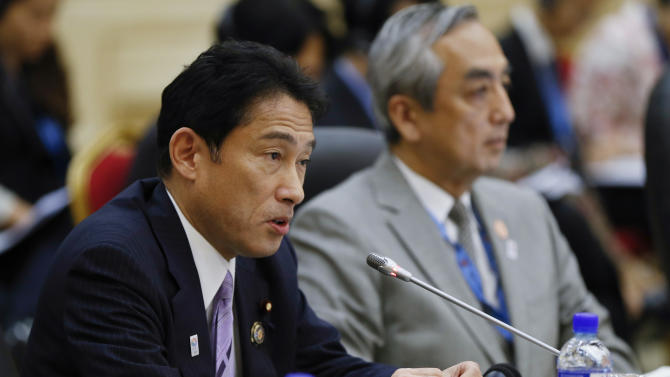 Japan's Foreign Minister Fumio Kishida, left, speaks during the 46th ASEAN Foreign Ministers' Plus Three Meeting in Bandar Seri Begawan, Brunei, Sunday, June 30, 2013. (AP Photo/Vincent Thian)