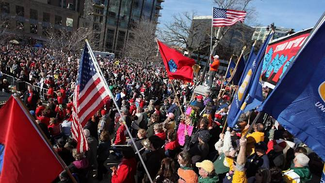 FILE - In this March 10, 2012, file photo, labor groups and others rally in front of the state capitol building in Madison, Wis. to recall Wisconsin Gov. Scott Walker. The effort to recall Walker has been so all-encompassing in Wisconsin, voters and GOP operatives admit to being distracted to the point of not even caring much about the upcoming April 3 presidential primary.  (AP Photo/Wisconsin State Journal, Craig Schreiner, File)