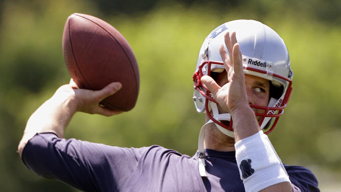 New England Patriots quarterback Tom Brady throws a pass during NFL football practice at the team's training facility in Foxborough, Mass., Thursday, May 31, 2012. (AP Photo/Stephan Savoia)