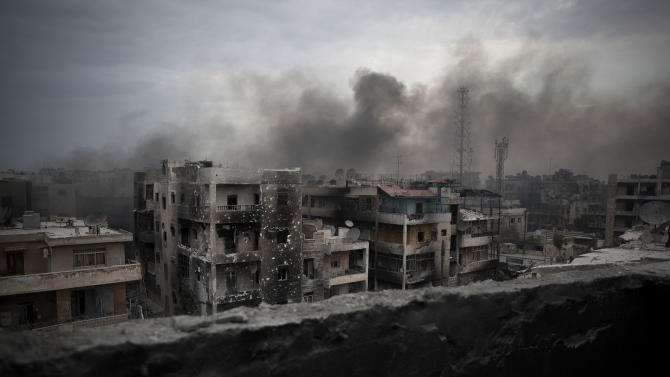 Smoke rises over Saif Al Dawla district in Aleppo, Syria, Tuesday, Oct. 2, 2012. The U.N.'s deputy secretary-general says U.N. chief Ban Ki-moon made a strong appeal to Syria's foreign minister to stop using heavy weapons against civilians and reduce the violence that is killing 100 to 200 people every day.(AP Photo/ Manu Brabo)