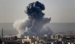 Smoke rises from the Syrian town of Kobani, seen from…