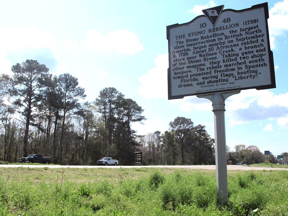 In this March 14, 2012 photo, a roadside marker stands along U.S. 17 west of Charleston, S.C.  The marker is near the site of where the Stono Rebellion, the largest slave insurrection in British North America, took place in 1739. (AP Photo/Bruce Smith)
