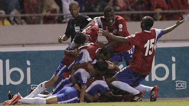 Costa Rica's players celebrate a goal against Panama during their 2014 World Cup qualifying match at the National Stadium in San Jose June 18, 2013 (Reuters)