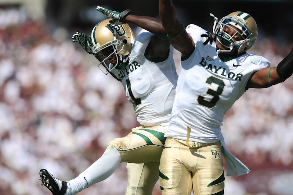 Baylor teammates Kendall Wright (1) and Lanear Sampson (3) celebrate after Wright scored during the first half of an NCAA college football game against Texas A&M Saturday, Oct. 15, 2011, in College Station, Texas. (AP Photo/Jon Eilts)
