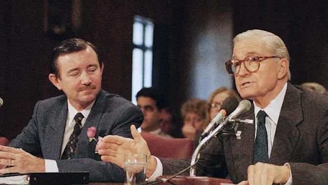FILE - In this Oct. 15, 1993 file photo, former Illinois Sen. Charles Percy, right, introduces Mark Hambley to the Senate Foreign Relations Committee, at Capitol Hill in Washington. West Virginia Sen. Jay Rockefeller's office says Saturday, Sept. 17, 2011, his father-in-law, former Illinois Sen. Percy, has died in Washington at age 91. (AP Photo/John Duricka, File)