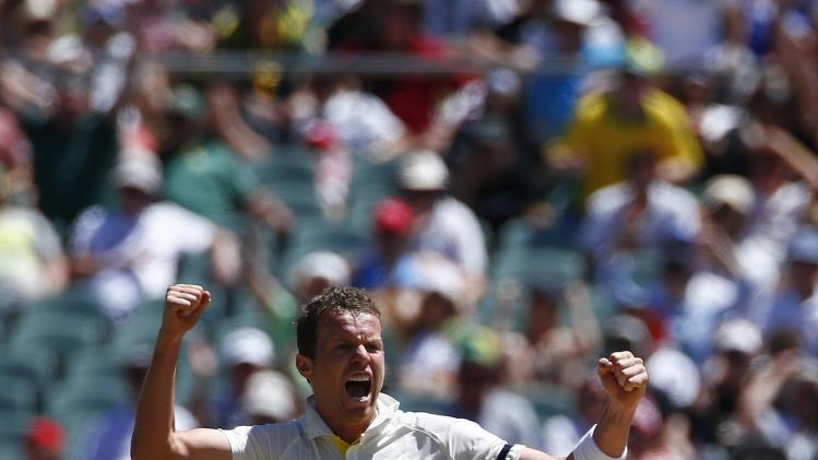 Australia's Siddle celebrates after taking the wicket of England's Pietersen during the third day of the second Ashes test cricket match in Adelaide