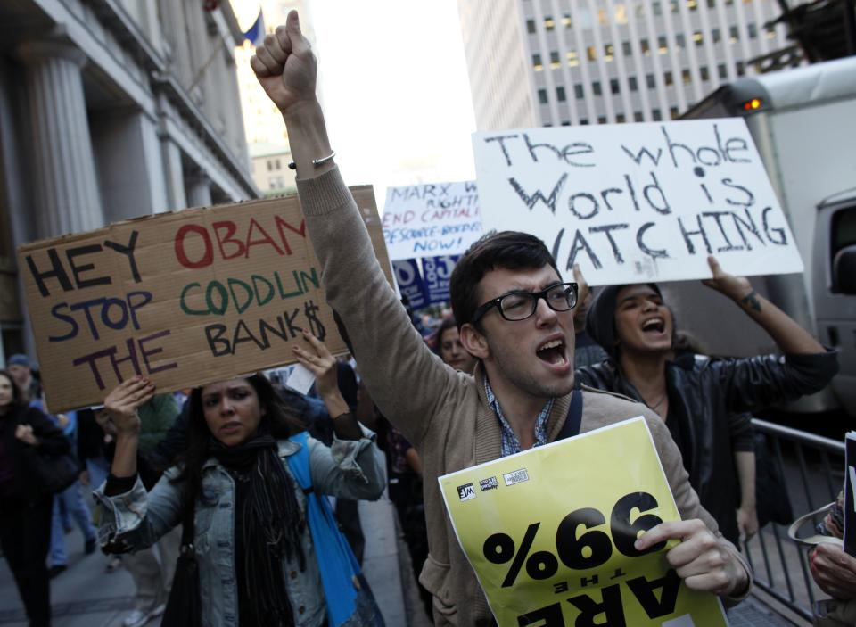 Occupy Wall Street protesters march towards Zuccotti Park in New York's Financial District, Wednesday, Oct. 5, 2011. (AP Photo/Jason DeCrow)