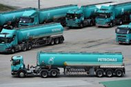 Petronas fuel tanker park at the Klang Valley Distribution Terminal (KVDT) in Dengkil outside Kuala Lumpur in September 2012. The Malaysian national oil company said it plans to appeal against Ottawa's rejection of its bid to buy Canadian gas producer Progress Energy Resources