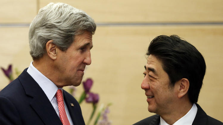 U.S. Secretary of State John Kerry, left, meets with Japan's Prime Minister Shinzo Abe at Abe's official residence in Tokyo Monday, April 15, 2013. Kerry is in Tokyo as part of Asian tour amid a tense situation over a possible missile launch by North Korea.  (AP Photo/Issei Kato, Pool)