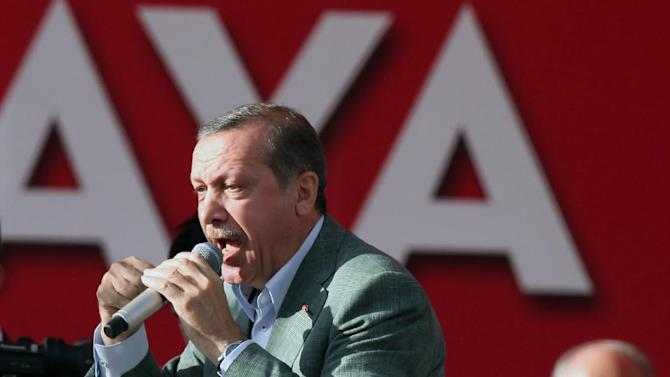 Turkish Prime Minister Recep Tayyip Erdogan addresses a party rally outside Ankara, Turkey, Saturday, June 15, 2013. Erdogan said Friday he has asked a small delegation of protesters to convince those occupying a park to withdraw, adding that he is hopeful their protest action would end soon.(AP Photo/Burhan Ozbilici)
