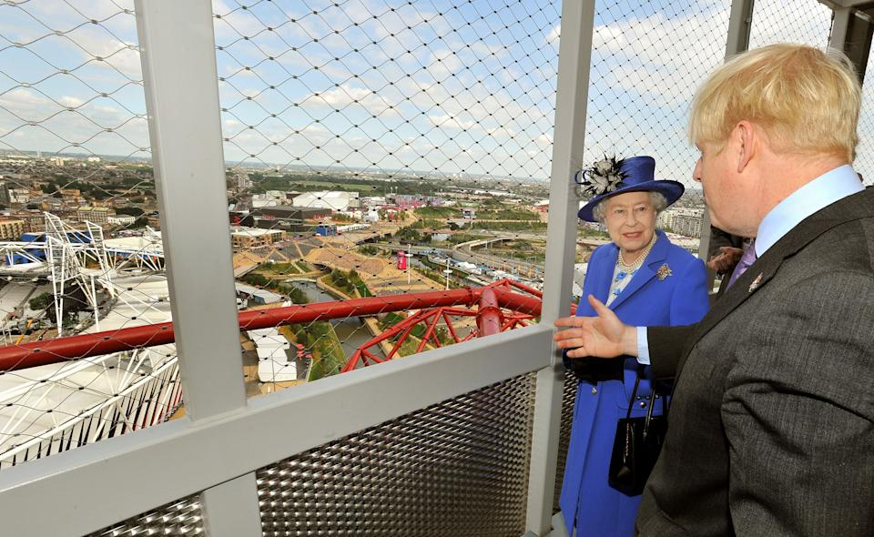 Queen Elizabeth II is shown the Olympic Stadium by London Mayor Boris Johnson from the top of the Orbit, during a short tour of the Olympic site in Stratford east London, Saturday July 28, 2012.  (AP Photo/John Stillwell, Pool)