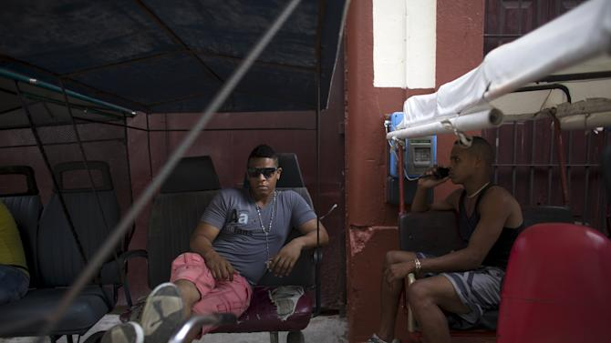 Pedicab driver Braison Navarro rests in his vehicle in downtown Havana