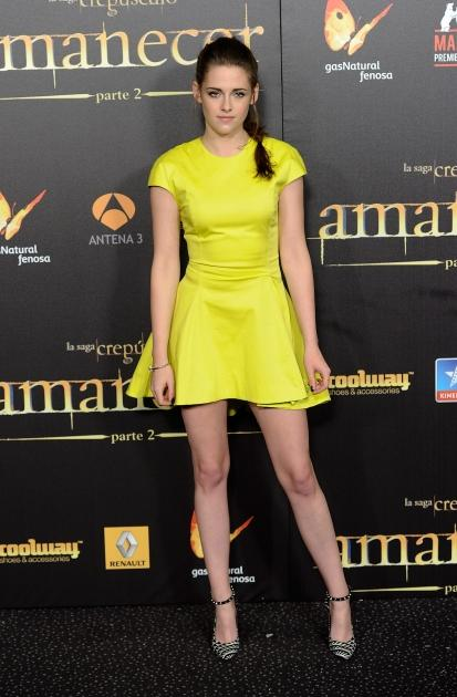 Kristen Stewart pops in a bright yellow dress at the premiere of 'The Twilight Saga: Breaking Dawn - Part 2' in Madrid on November 15, 2012  -- Getty Premium