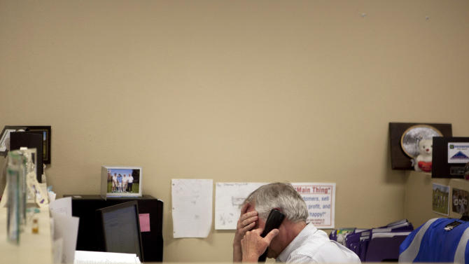 In this Feb. 15, 2012 photo, Steve Wyard, 61, a regional sales director of All Valley Washer Service, talks on the phone in his office in the Van Nuys section of Los Angeles. Wyard and his wife have two sons, 19 and 21, to put through college, and they see that pushing back retirement for several years. Until then Wyard plans to keep working. (AP Photo/Jae C. Hong)