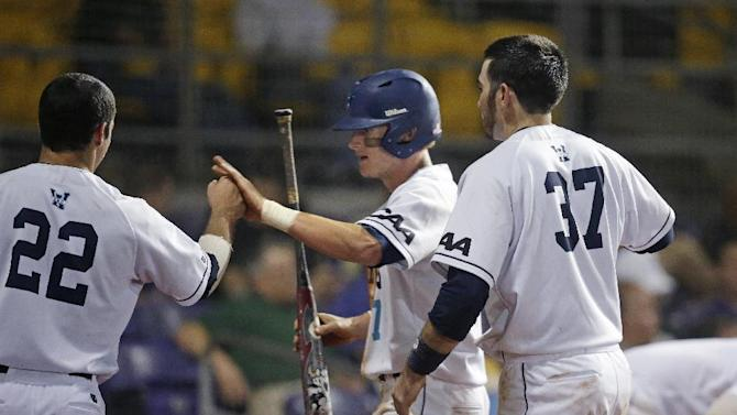 UNC-Wilmington's Steven Linkous (7) is greeted by outfielder Robbie Thorburn (22) and Terence Connelly after scoring  in the fourth inning of a game against Tulane at the Baton Rouge Regional of the NCAA college baseball tournament in Baton Rouge, La., Friday, May 29, 2015. UNC-Wilmington won 10-1. (AP Photo/Gerald Herbert)
