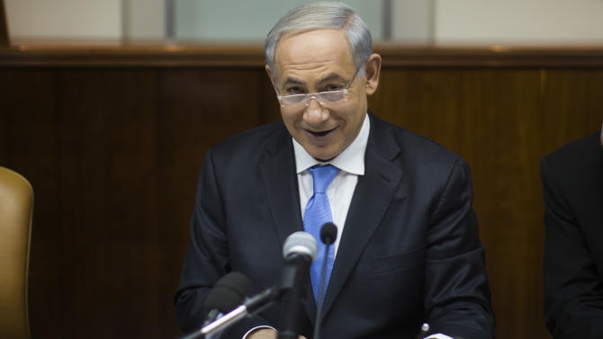 Israel's Prime Minister Benjamin Netanyahu, chairs the weekly cabinet meeting in Jerusalem, Sunday, Dec. 8, 2013. (AP Photo/Uriel Sinai, Pool)