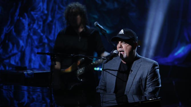 """In this photo provided by NBC, Billy Joel performs during """"Hurricane Sandy: Coming Together"""" Friday, Nov. 2, 2012, in New York. Hosted by Matt Lauer, the event is heavy on stars identified with New Jersey and the New York metropolitan area, which took the brunt of this week's deadly storm. (AP Photo/NBC, Heidi Gutman)"""