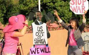 Code Pink demonstrators protest against potential U.S. military action in Syria at the U.S. Capitol in Washington