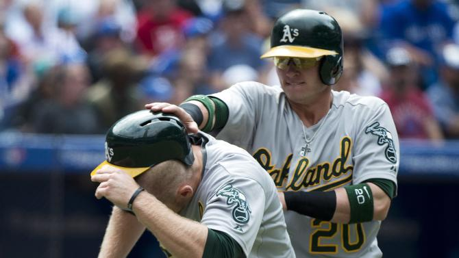 Callaspo double helps A's beat Blue Jays
