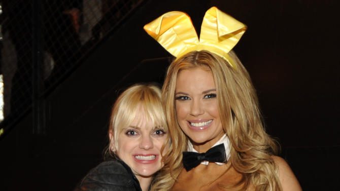 IMAGE DISTRIBUTED FOR CROWN ROYAL - Actress Anna Faris stuffs a Crown Royal camo care package for U.S. troops overseas with Playboy Playmate Jessa Hinton during the Playboy Party presented by Crown Royal, Friday, Feb. 1, 2013, in New Orleans. The packages will be shipped as part of the Crown Royal Heros Project honoring American soldiers. (Photo by Jack Dempsey/Invision for Crown Royal/AP Images)