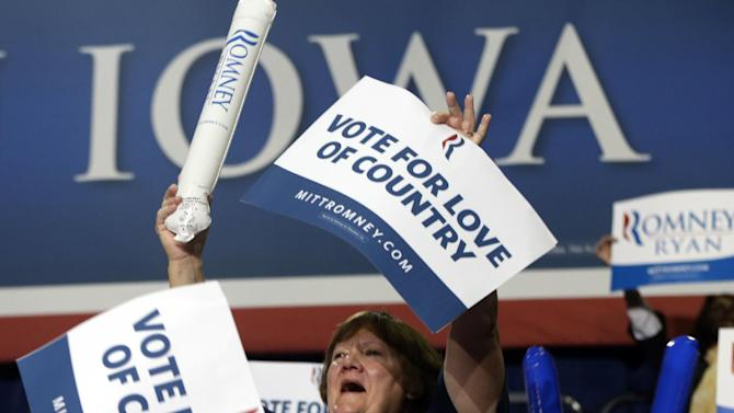 A supporter cheers for Republican presidential candidate and former Massachusetts Gov. Mitt Romney as he campaigns at Iowa Events Center, in Des Moines, Iowa, Sunday, Nov. 4, 2012. (AP Photo/Charles Dharapak)