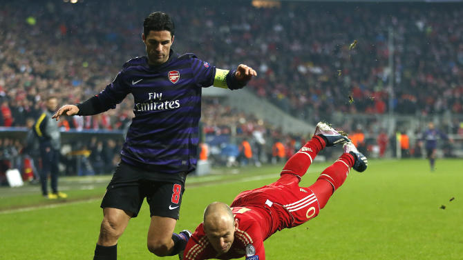 Arsenal's Mikel Arteta, left, and Bayern's Arjen Robben of the Netherlands challenge for the ball during the Champions League round of 16 second leg soccer match between FC Bayern Munich and FC Arsenal in Munich, Germany, Wednesday, March 13, 2013. (AP Photo/Matthias Schrader)