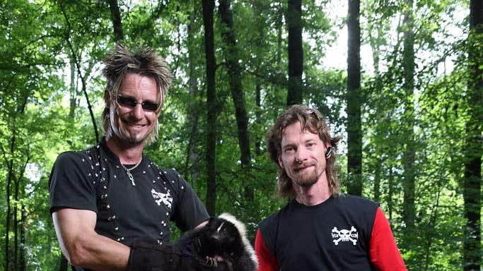 "Billy and Rick Bretherton show off their latest catch: a nosey skunk, before they release it back into the wild and far away from their clients' homes in ""The Exterminators."""
