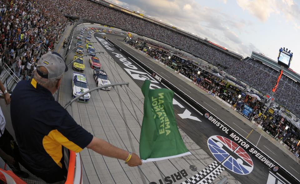 The green flag is waved to start the NASCAR Sprint Cup Series auto race on Saturday, Aug. 25, 2012, in Bristol, Tenn. (AP Photo/Jason Smith, CIA Bristol Motor Speedway, Pool)