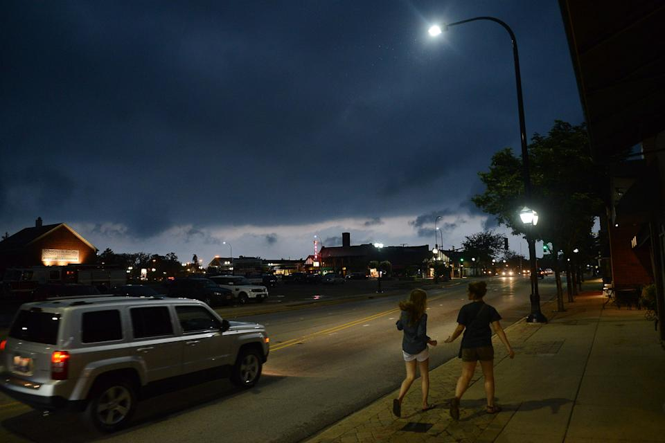 Threatening skies appear over Barrington, Ill. as severe weather approaches the Suburbs of Chicago on Wednesday, June 12, 2013. (AP Photo/Daily Herald, Bob Chwedyk) MANDATORY CREDIT; MAGS OUT, TV OUT