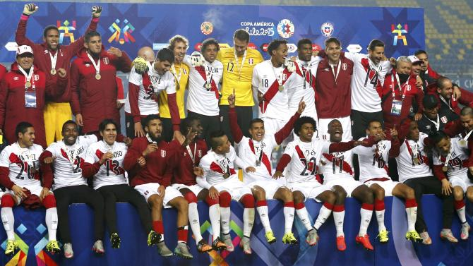 Peru players pose with their medals after defeating Paraguay in their Copa America 2015 third-place soccer match at Estadio Municipal Alcaldesa Ester Roa Rebolledo in Concepcion