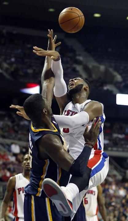 Detroit Pistons center Andre Drummond, right, has his shot blocked by Indiana Pacers center Roy Hibbert, left, during the second half of an NBA basketball game Tuesday, Nov. 5, 2013, in Auburn Hills,