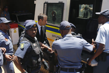South African Olympic and Paralympic sprinter Pistorius enters a police van after his sentencing at the North Gauteng High Court in Pretoria